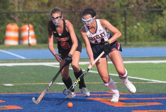 From left, Mamaroneck's Kate Marcus (8) and Horace Greeley's Sophia Rutman (14) battle for ball control during field hockey action at Horace Greeley High School in Chappaqua Sept. 10, 2019.  The game ended in a 1-1 tie.