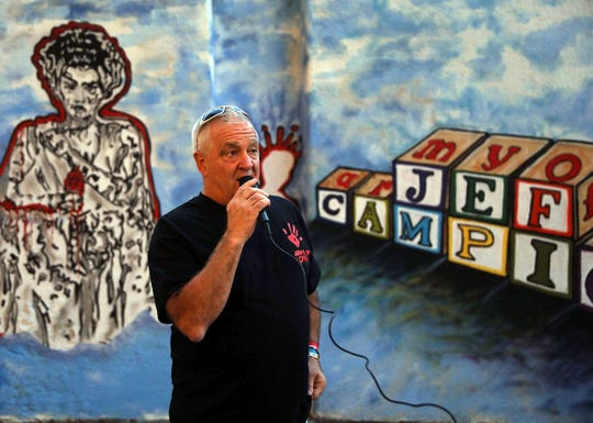 Louie Vellucci, a close friend of Jef Campion talks about him during the unveiling of a mural dedicated to him in Yonkers Sept. 10, 2019. Campion who was a street artist and firefighter died by suicide in 2014 after enduring post-9/11-related illness.