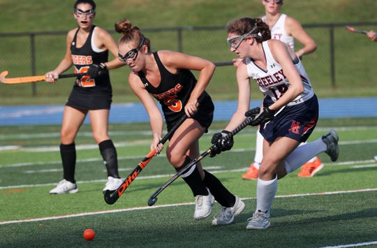 From left, Mamaroneck's Sophie Showers (5) and Horace Greeley's Talia Williams (15) battle for ball control during field hockey action at Horace Greeley High School in Chappaqua Sept. 10, 2019.  The game ended in a 1-1 tie.