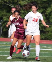 Albertus Magnus' Isabel DiPrima, left, fights for the ball with Somers' Dahlia Pepe during their game at Albertus Sept. 10, 2019. Albertus won 2-1 in OT.