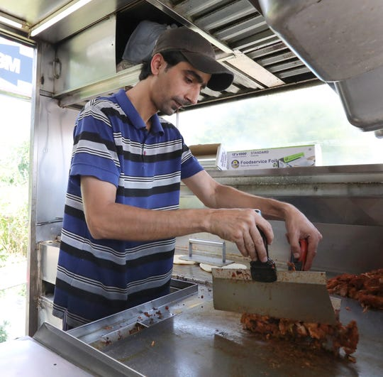 Tahir Ali works at Rockland Halal Gyro in Spring Valley Sept. 11, 2019.