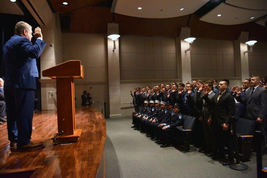Yonkers Mayor Mike Spano swears in 31 new firefighters at the city's Riverfront Library on Sept. 6, 2019.