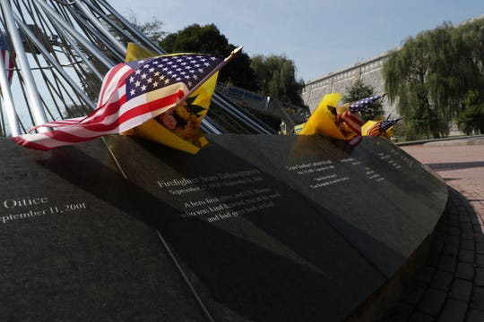 Flags are left over the names of fallen firefighters at the Westchester County September 11th Memorial called The Rising at the Kensico Dam prior to the start of the ceremony Sept. 11, 2019.