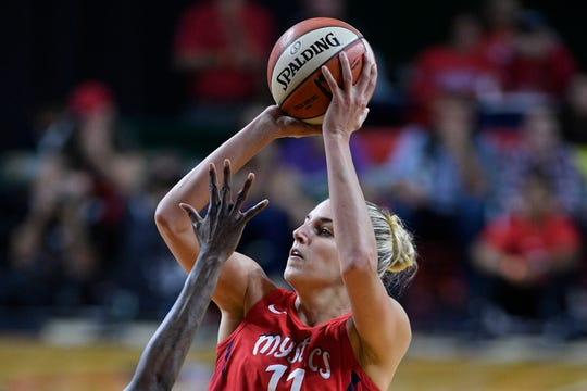 In this Sept. 12, 2018, file photo, Washington Mystics forward Elena Delle Donne (11) shoots against the Seattle Storm during the second half of Game 3 of the WNBA basketball finals, in Fairfax, Va. Delle Donne was named the Associated Press WNBA OPlayer of the Year, Wednesday, Sept. 11, 2019.