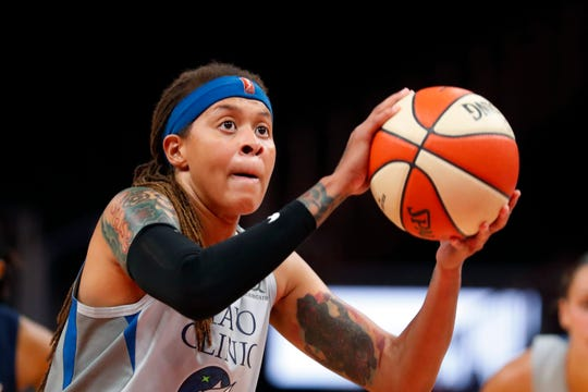 In this Aug. 6, 2019, file photo, Minnesota Lynx forward Napheesa Collier (24) shoots a free throw during the first half of a WNBA basketball game against the Atlanta Dream, in Atlanta. Collier was named the Associated Press WNBA Rookie of the Year, Wednesday, Sept. 11, 2019.