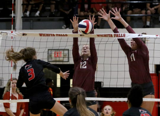 Bowie's Abbi Gamblin (12) and Lexi Kirkham (11) block Wichita Falls High's Haylee Robertson Tuesday, Sept. 10, 2019, at Old High.