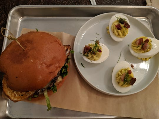 Wagyu Burger with fried egg and deviled eggs at Progress and Provisions.