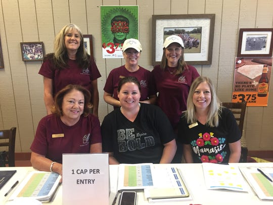 Senior-Junior Forum members recently helped with registration at the Beacon Lighthouse for the Blind Carolyn Stouard Memorial Golf Tournament. From left to right: Robin Bowen, Dusty Sternadel, Christi Kelton Back row, left to right: Mary McCollum, Vicky Payne, Trisha Hoover.