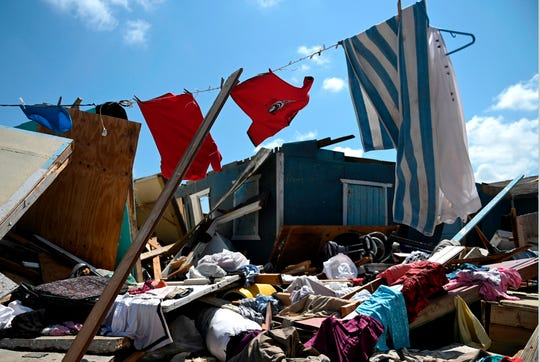 Clothes dry on a line in an abandoned destroyed home in Marsh Harbour, Bahamas on Sept. 10, 2019, one week after Hurricane Dorian.