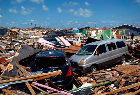 Two cars are seen in an area destroyed by a storm surge  in Marsh Harbour, Bahamas on Sept. 10, 2019, one week after Hurricane Dorian.