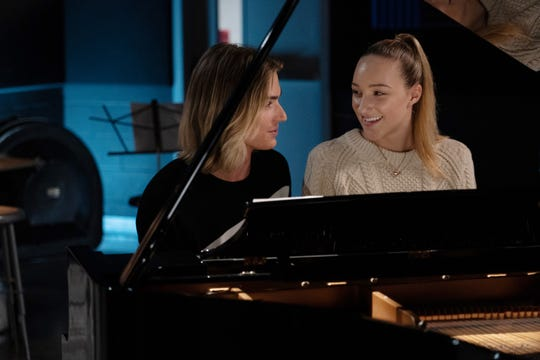 Jodi (Michelle) sits at a piano with Stig (Eisner).