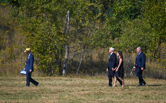 Vice President Mike Pence and Karen Pence and Secretary of the Interior David Bernhardt, right, follow Families of Flight 93 president Gordon Felt, left, walking to the impact area along with families following the 18th anniversary ceremony of the hijacked Flight 93, which crashed in near Shanksville, PA, killing 40 passengers and crew on September 11, 2001.