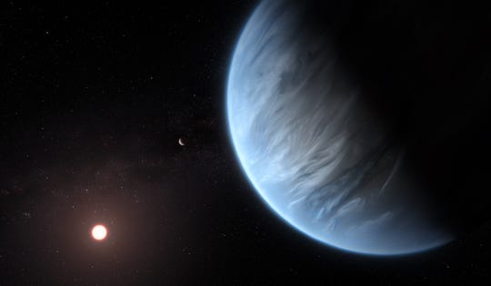 An artist's conception shows the planet K2-18b, its host star and an accompanying planet. K2-18b is now the only super-Earth exoplanet known to host both water and temperatures that could support life.