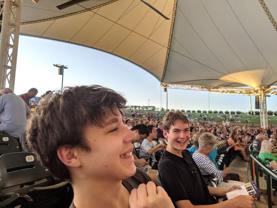 The author's sons, Iden and Aren Elliott, enjoy a free concert by the Houston Symphony in The Woodlands, a Houston suburb. It's just one of the things to do in Houston with kids.