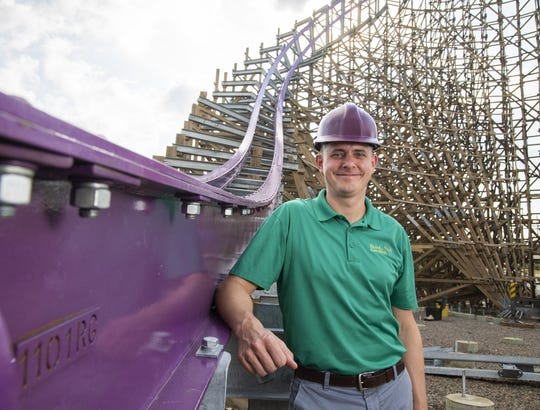 Jonathan Smith, director of rides and engineering for SeaWorld Parks stands next to Iron Gwazi, a 20-year-old wooden coaster getting a new life and new thrills thanks to newly laid steel tracks.