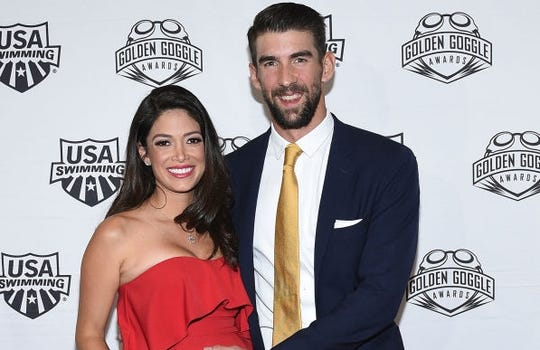 Michael Phelps and family cuddle third son after birth. See the adorable photos