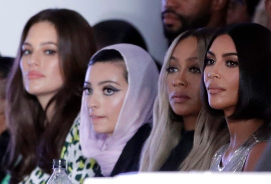 Kim Kardashian West, right, La La Anthony, second from right, and model Ashley Graham, left, were among the spectators at the S by Serena fashion show.