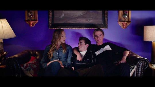 Jodi (Michelle) watches a movie with Dunkleman (Griffin Gluck) and Stig (Eisner).