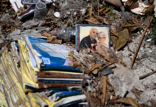 A couples photograph is seen amongst the rubble in Marsh Harbour, Bahamas on Sept. 10, 2019, one week after Hurricane Dorian.