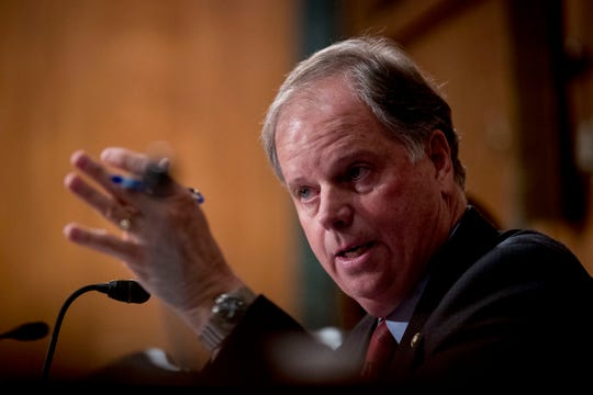 "Sen. Doug Jones, D-Ala., speaks at a Senate Banking Committee hearing on ""Housing Finance Reform: Next Steps"" on Capitol Hill, Tuesday, Sept. 10, 2019, in Washington. Trump administration officials appear before Congress to defend their plan for ending government control of Fannie Mae and Freddie Mac. (AP Photo/Andrew Harnik) ORG XMIT: DCAH124"