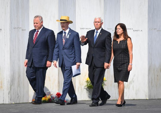Vice President Mike Pence along with Karen Pence, Secretary of the Interior David Bernhardt, and Families of Flight 93 president Gordon Felt walk along the Flight 93 National Memorial Wall of Names.