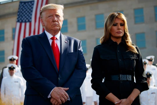 President Donald Trump and first lady Melania Trump participate in a moment of silence honoring the victims of the Sept. 11 terrorist attacks, Wednesday, Sept. 11, 2019, at the Pentagon.