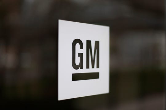 This May 16, 2014, file photo, shows the General Motors logo at the company's world headquarters in Detroit. Under pressure from the federal government, General Motors is recalling more than 3.4 million big pickup trucks and SUVs in the U.S to fix a brake problem.