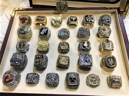 This photo provided by U.S. Customs and Border Protection shows a collection of counterfeit NBA championship rings that have been seized by federal authorities at Los Angeles International Airport.