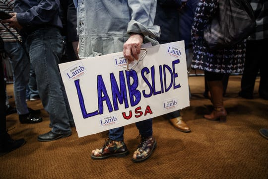 A supporter holds a sign in support of Rep. Conor Lamb on March 13, 2018.
