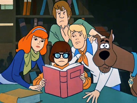 """Daphne, left, Velma, Shaggy, Fred and Scooby in the original """"Scooby-Doo, Where Are You!,"""" which premiered in 1969 and ran for three seasons."""
