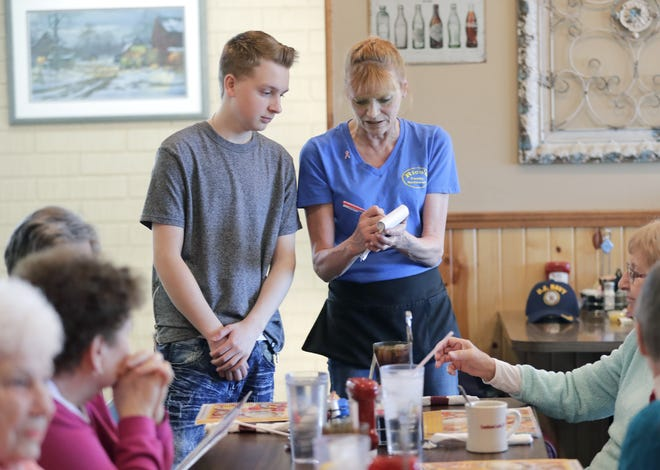 In this 2018 photo of Rico's Family Restaurant in Combined Locks, Julie Siebers trains new employee Logan Bartman.