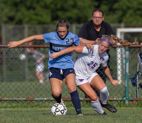Freehold Township Sam Linico and Rumson Brynn Pritchard battle for control of ball during first half action. Freehold Township girls soccer vs Rumson-Fair Haven in Freehold Township on 09/11/19.