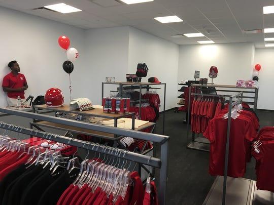 The Adidas store. Peter Millar polo shirt: $115.00. Rutgers baseball cap: $30.