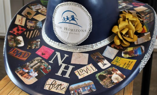 The New Horizons cowboy hat was accented with bling and pasted with images representing happiness for the first Hats off to Abilene contest at the West Texas Fair & Rodeo. Sept. 11 2019
