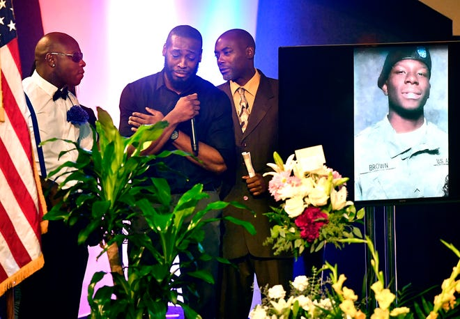 Singing the Postlude song at Kameron Brown's funeral Thursday, Morsello Hooker, center, falters momentarily as Carlton Brown (left) and Carlos Washington, brothers to Kameron, lend him support Sept. 12, 2019. Kameron was one of seven people killed in Odessa by a gunman August 31, he was eulogized Thursday at Victory Life Church in Brownwood and interred at Eastlawn Memorial Park in Early.