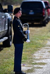 U.S. Army Specialist Ellen Margritt Bagdan stands by to play Taps at the graveside service for Kameron Brown Thursday Sept. 12, 2019 in Early. Brown was one of seven killed in Odessa by a gunman August 31.