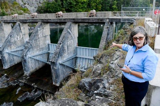 Duke Energy's Lisa Leatherman discusses the spillway gates at Nantahala Lake September 4, 2019.