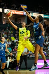 Seattle Storm's Jordin Canada drives past q Minnesota Lynx player during the first half of a WNBA basketball Western Conference semifinal, Wednesday, Sept. 11, 2019, in Everett.