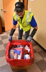 Jim Kington, Waste Management Recycling Brevard operations supervisor, holds a 30-gallon cardboard box filled with improperly discarded hypodermic needles.