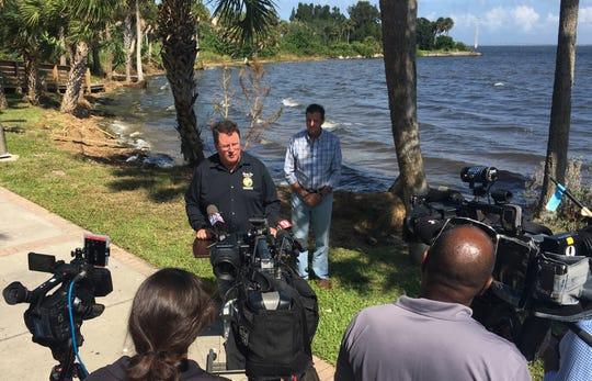 Rep. Randy Fine, flanked by Peter Barile, science director of the American Water Security Project, announces his proposed legislation Thursday that would put $50 million in state money toward sewer system upgrades along the Indian River Lagoon region and toward getting more homes hooked up to sewer systems.