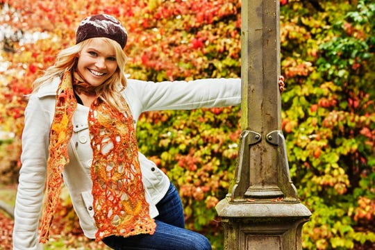 This model looks so happy in her colorful scarf and cute hat. We Floridians won't be donning outfits like this anytime soon.