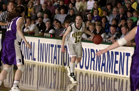 UVM's Libby Smith brings the ball down the court against Holy Cross during a 2002 NIT game at Patrick Gym.