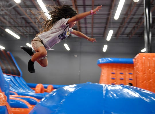 Four-year-old Kyng Le jumps at the Amped Inflatapark, Tuesday, Sept. 10, 2019. The park had a preview day with its PLAY clients.