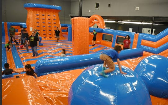Children play at the Amped Inflatapark's, Tuesday, Sept. 10, 2019. This is the only park of its kind in Texas.