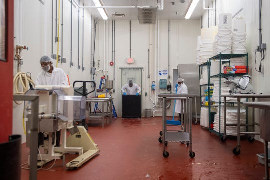 Leonard Brown, from left, James Butcher and Thomas Burch work sanitation and production inside the Rutgers Food Innovation Center in Bridgeton, N.J. Friday, Sept. 6, 2019.