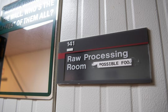 A leftover label from Impossible Foods remains at the entrance of the raw processing room inside the Rutgers Food Innovation Center in Bridgeton, N.J. Friday, Sept. 6, 2019.