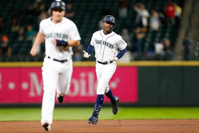 Seattle Mariners right fielder Kyle Lewis (30) reacts as he runs the bases after hitting a three-run home run against the Cincinnati Reds during the seventh inning at T-Mobile Park on Wednesday night.