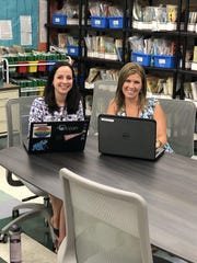 The districts newly-appointed Literacy Coach Nicole Maraventano and newly appointed Math Coach Jodi Rehrig are photographed on the first day planning at Three Bridges School.
