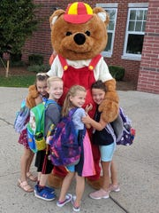 Students in the Readington School District returned for the 2019-2020 school year on Thursday, Sept. 5. The students at Whitehouse School were greeted by Cubby and Superintendent, Dr. Jonathan Hart.  Pictured above are first graders: Eliza Adams, Patrick Ost, Phoebe King, and Claire Ryan with Cubby, the Whitehouse School mascot.