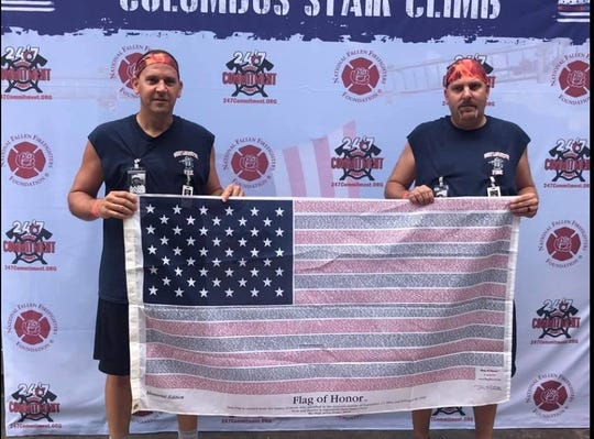 Tony Griffith and Brandon Bradford of the West Lafayette Fire Department are seen after completing the 9/11 Memorial Stair Climb Sept. 8 at Chase Tower in Columbus. Each man walked to honor a firefighter who died in the 9/11 terrorist attacks and former Coshocton Fire Department Chief Wilmer Hale, who died in 1975 in the line of duty.
